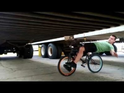 youtube-bmx-expert-tim-knoll-explains-how-to-bike-limbo-under-big-rigs